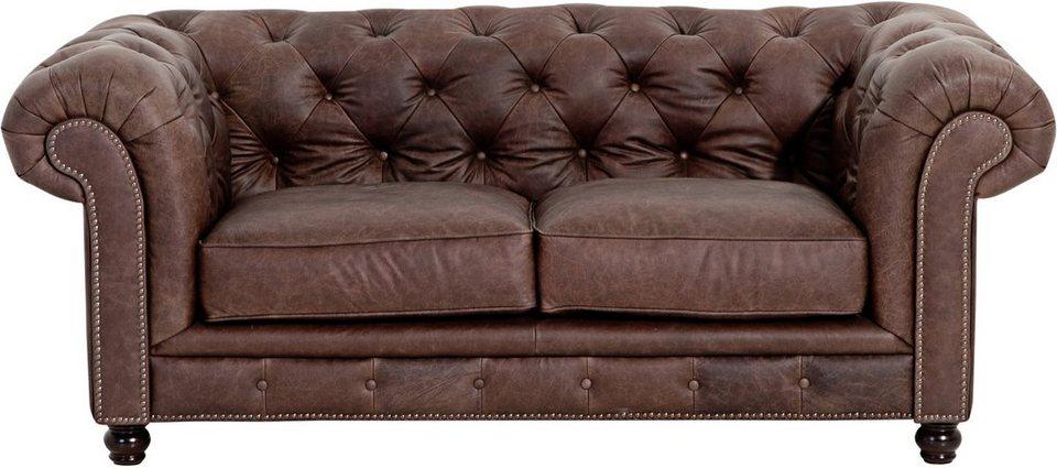Retro Sofa in petrol mit farbigen Zierknöpfen