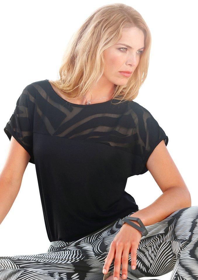 Création L Shirt mit überschnittenen Schultern in schwarz