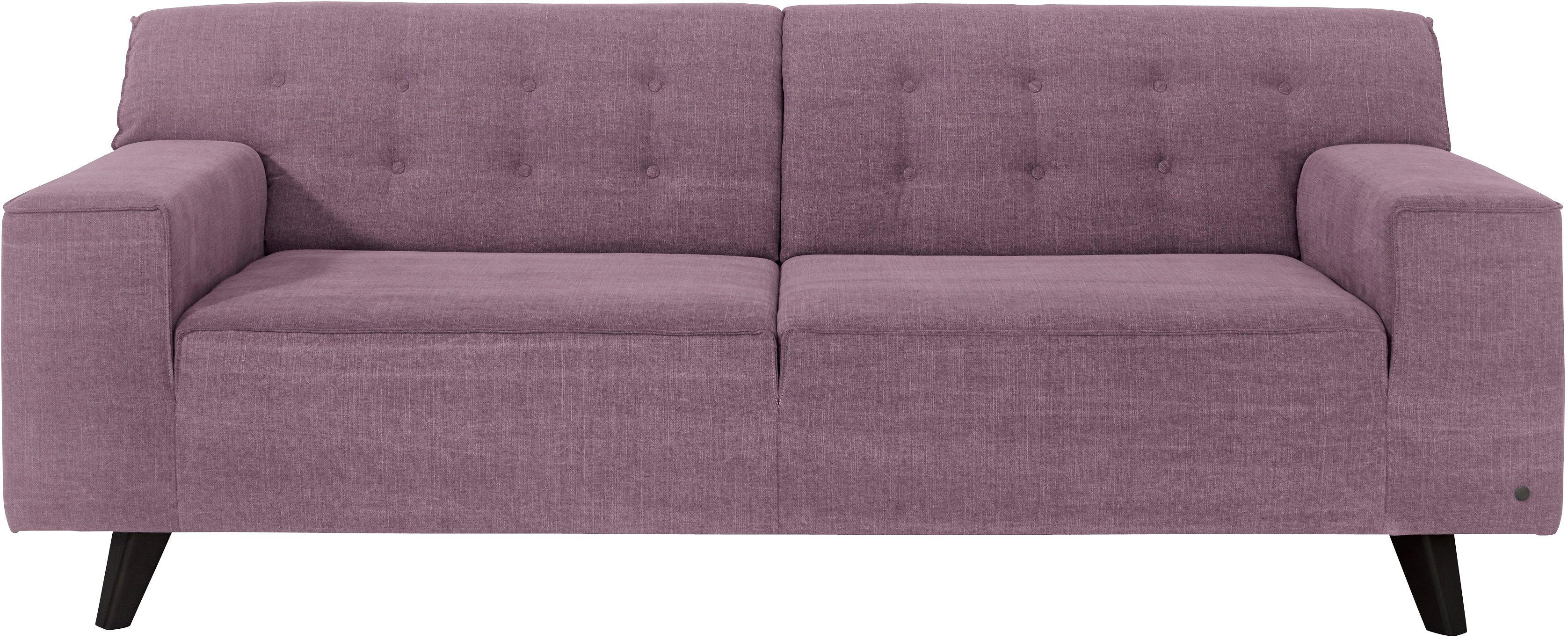 Retro Sofa in rosa/lila mit auffälligen Holzfüßen