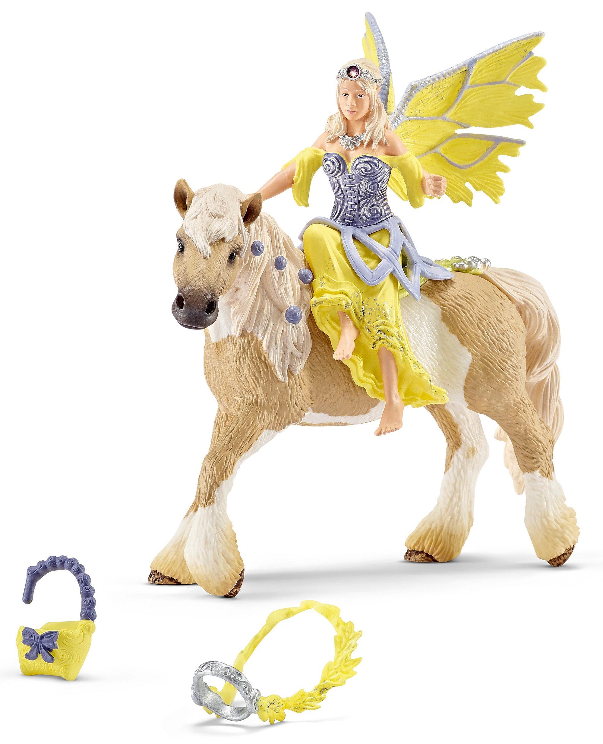 Schleich® Spielfigur, »World of Fantasy bayala - Sera in festlicher Kleidung, reitend«