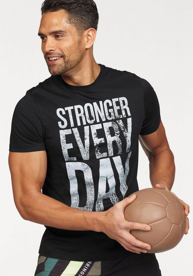 Reebok T-Shirt »Stronger Everyday Graphic Tee« in schwarz