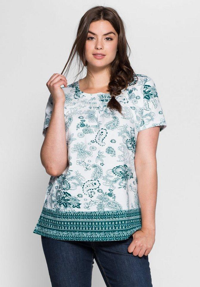 sheego Casual T-Shirt mit Allover- und Bordürendruck in weiß-petrol