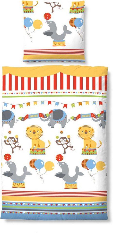 Kinderbettwäsche, biberna, »Zirkus«, mit Zirkusmotiven in orange-multi