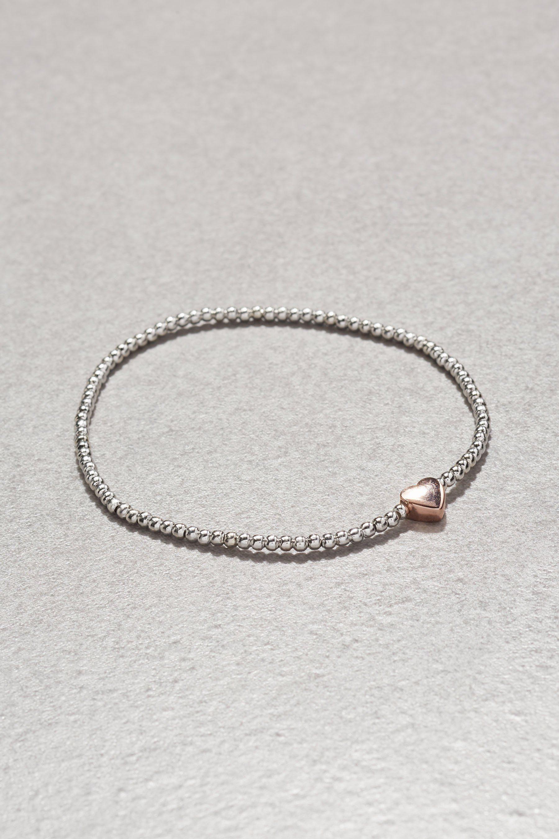 Next Armband in Perlenoptik mit Charm