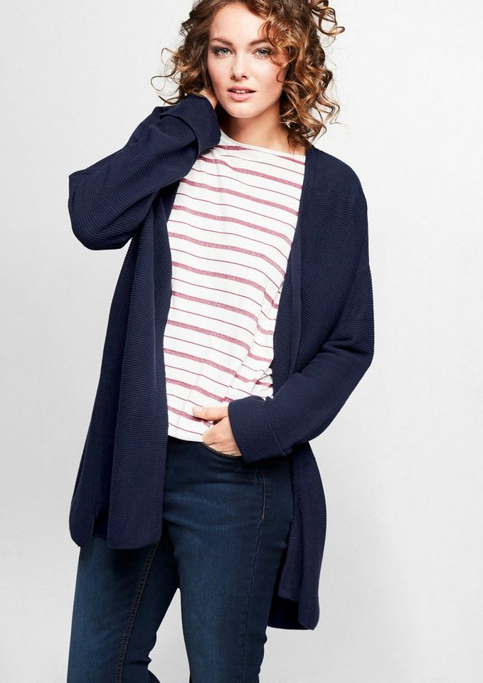 Buy Cardigans Online - Up Your Winter Fashion Game Originally a man's knitted waistcoat, cardigans have come a long way to become a must-have in every woman's wardrobe. A cardigan is a simple knitted garment that fastens down the front.