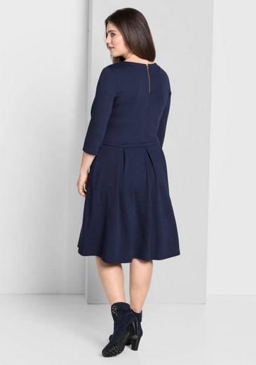sheego Style Jerseykleid, schwingendes Rockteil mit Kellerfalten