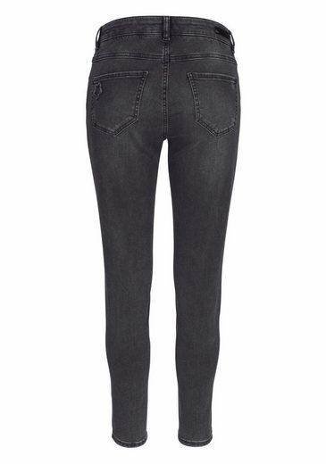 Parler De Jeans Skinny Fit, Avec Des Patchs Étoiles