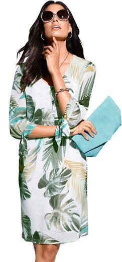 Création L Kleid mit transparenten Ärmeln