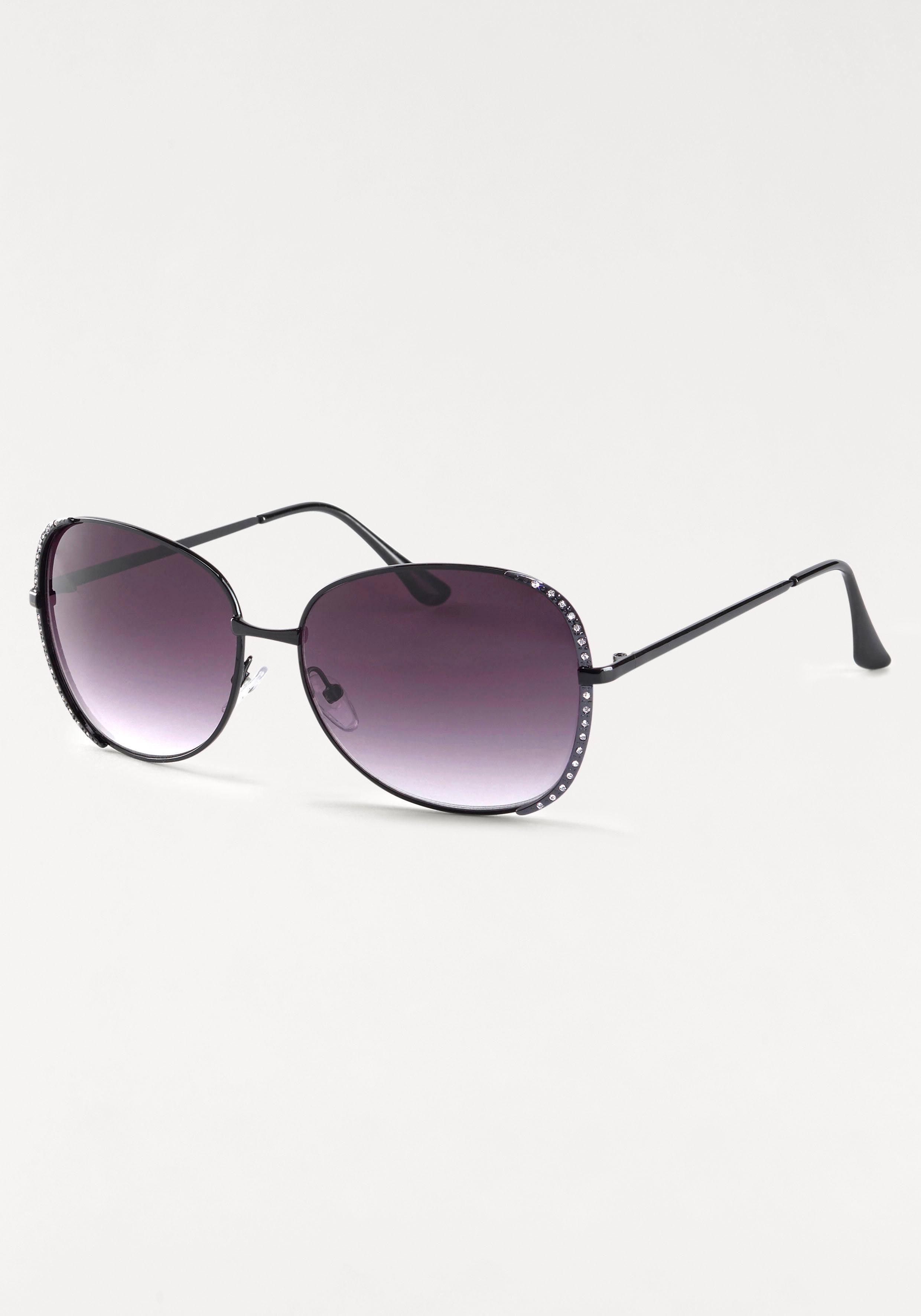 Sonnenbrille, mit Glitzersteinen am Rand, Oversize Look