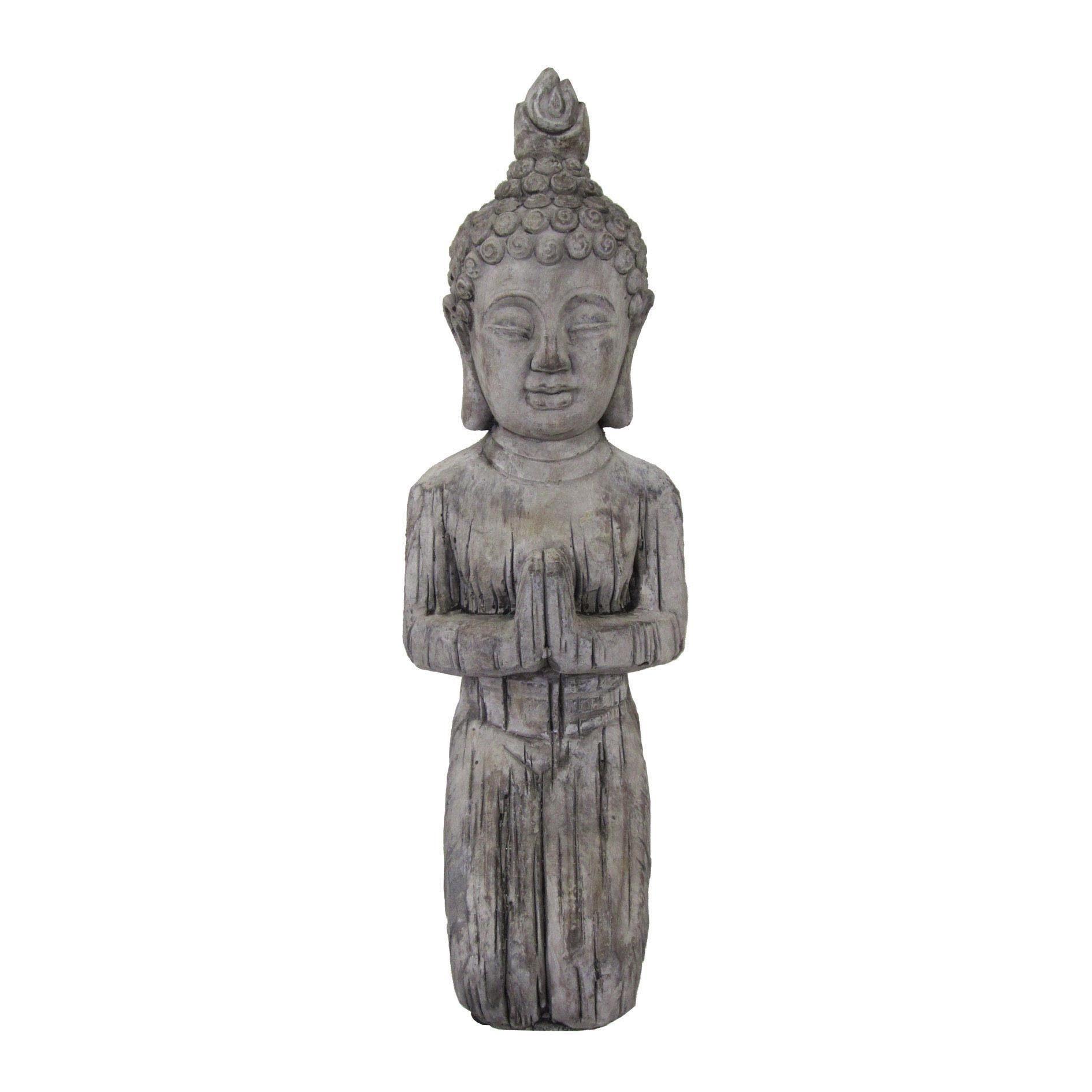 Cement Buddha knieend