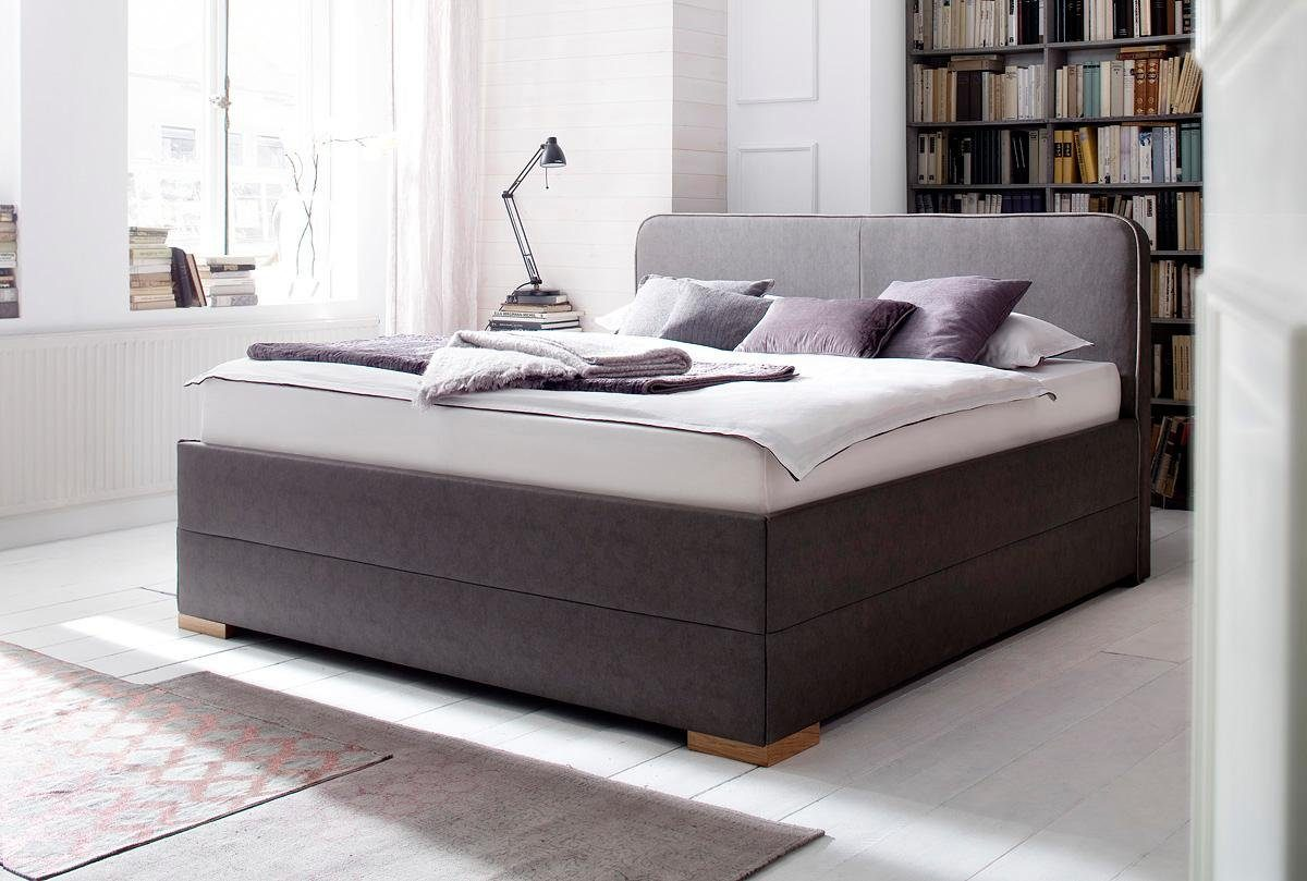 meise.möbel Polsterbett mit Eck-Holzfüße in massiv eichenfarbig