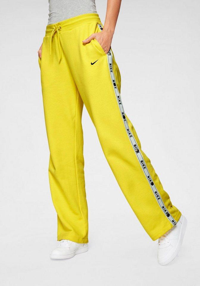 nike sportswear -  Sporthose »WOMAN  PANT LOGO TAPE POPPER« Mit Druckknöpfen an den Beinen