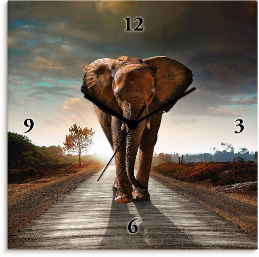 Artland Wanduhr »Ein Elefant läuft auf der Straße«