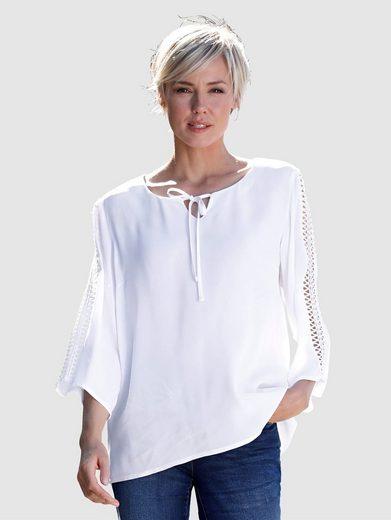 Dress In Bluse mit Crochettape Arm