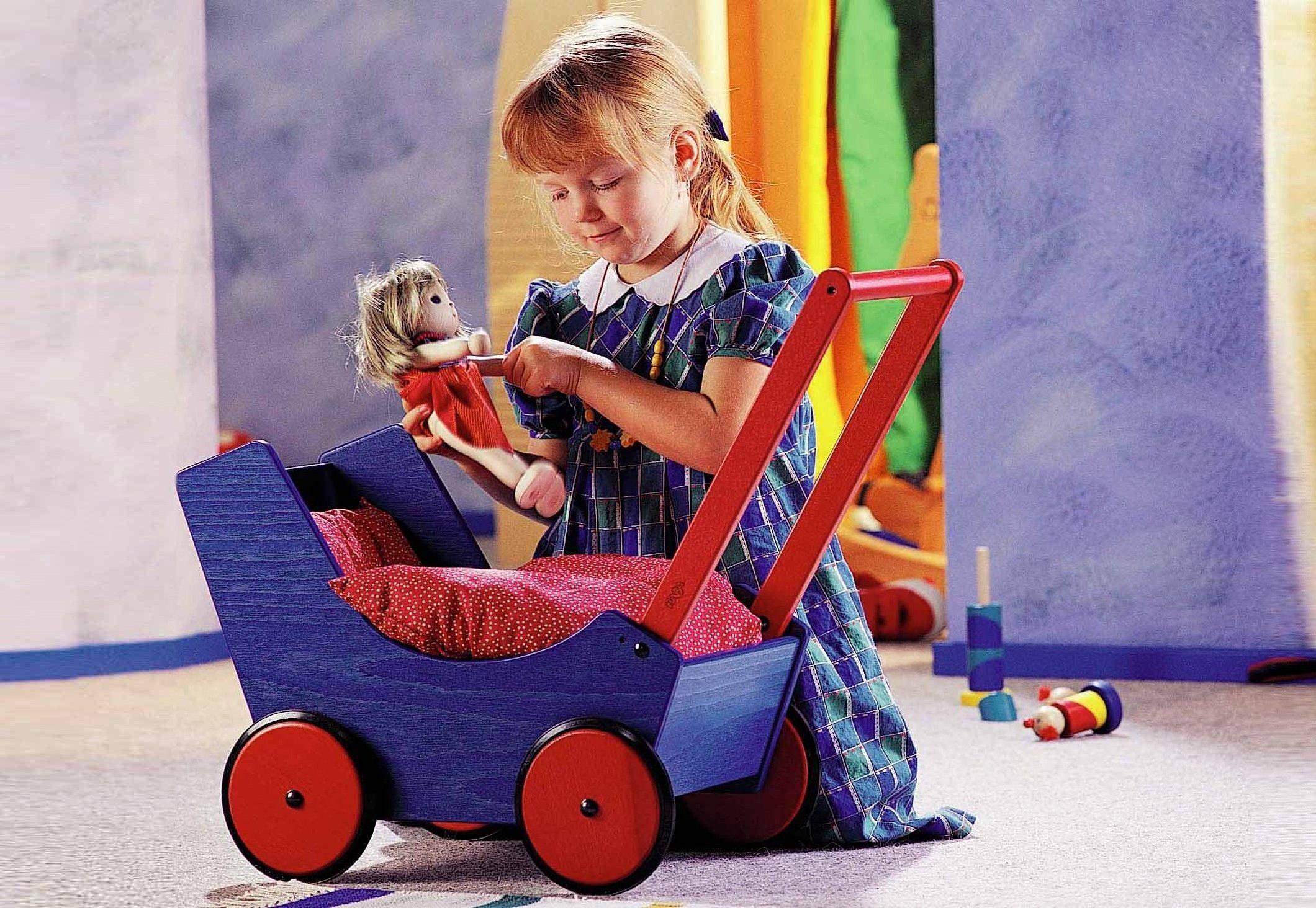 HABA® Puppenwagen aus Holz mit Bettzeug