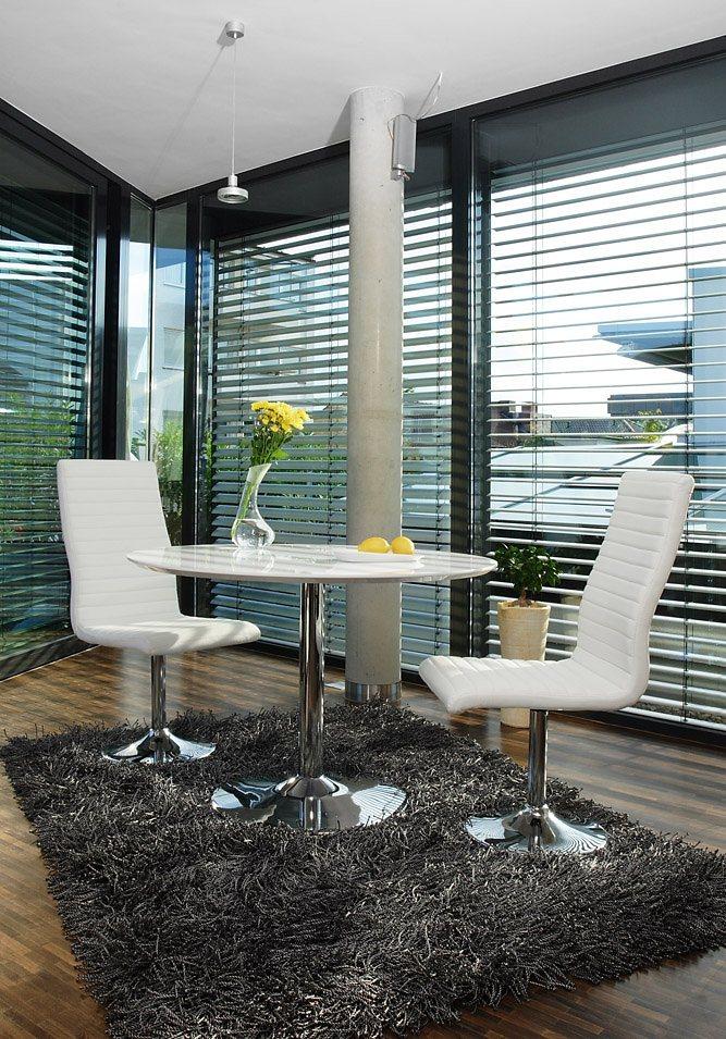 SalesFever Nuni Esstisch rund 110cm mit 4 Lio Kunstlederstühlen weiß in weiß