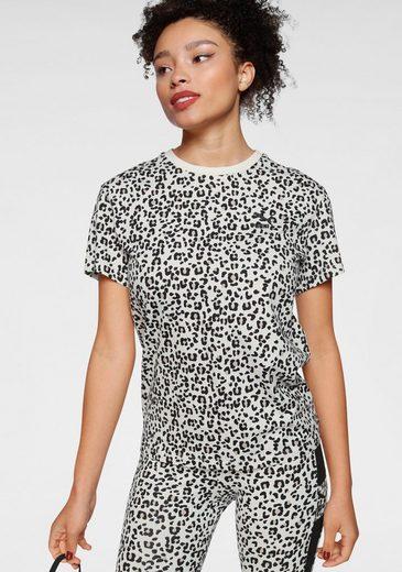 PUMA T-Shirt »Classics AOP Logo Tee«