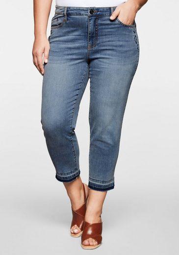 Sheego Stretch-Jeans in 7/8-Länge mit Destroyed-Effekten und offenem Saumabschluss