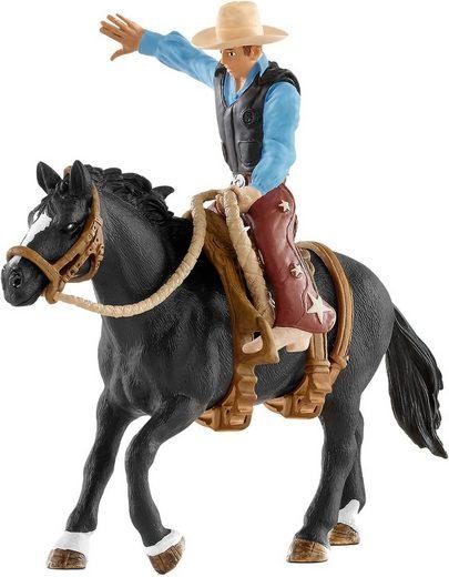 Schleich® Spielfigur »Schleich 41416 Saddle bronc riding mit Cowboy«