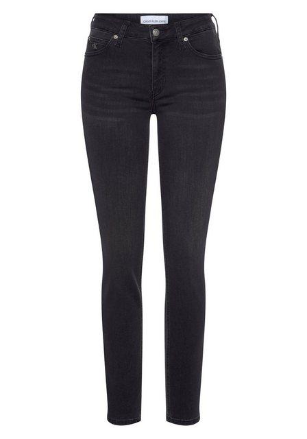 Hosen - Calvin Klein Jeans Skinny fit Jeans »CKJ 011 MID RISE SKINNY« mit Fadeout Effekt, Calvin Klein Jeans Markenlabel CK Stickerei › schwarz  - Onlineshop OTTO